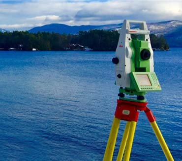 Land Surveying equipment overlooking Lake George