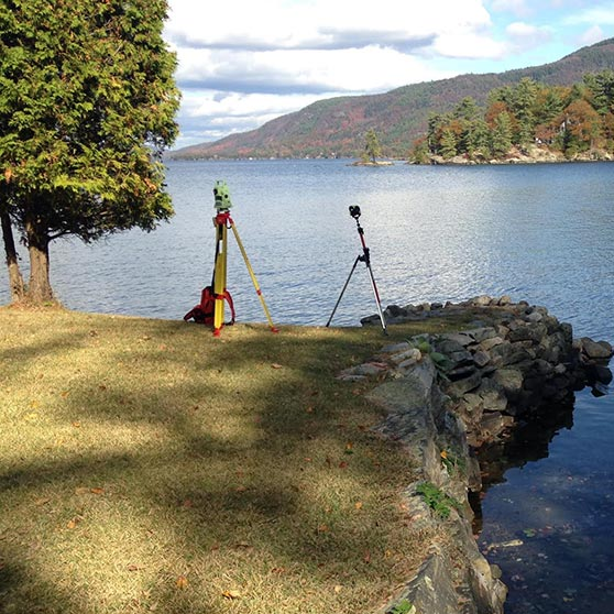View of Lake George with land surveying equipment